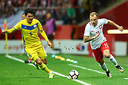 Warsaw, Poland - 2017 September 04: (R) Kamil Grosicki from Poland fights for the ball with (L) Yeldos Akhmetov from Kazakhstan during soccer match Poland v Kazakhstan - FIFA 2018 World Cup Qualifier at PGE National Stadium on September 04, 2017 in Warsaw, Poland.<br /> <br /> Adam Nurkiewicz declares that he has no rights to the image of people at the photographs of his authorship.<br /> <br /> Picture also available in RAW (NEF) or TIFF format on special request.<br /> <br /> Any editorial, commercial or promotional use requires written permission from the author of image.<br /> <br /> Mandatory credit:<br /> Photo by &copy; Adam Nurkiewicz / Mediasport