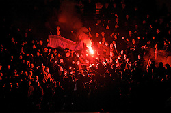 MANCHESTER, ENGLAND - Wednesday, November 10, 2010: Manchester United fans light a flare prior to the Premiership match at the City of Manchester Stadium. (Pic by: Chris Brunskill/Propaganda)