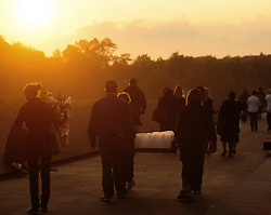Volunteers carry sets of luminaria representing each of the 2,977 people lost on September 11, 2001. Fifty-seven sets of volunteers placed  lumiaria along the length of the Flight 93 National Memorial located in Shanksville, Pa. Saturday, Sept 10, 2011.