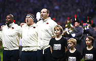 6 Feb 2010 Twickenham, England: L to R Ugo Monye, Dylan Hartley, Steve Borthwick, sing the national anthem with mascots Archie Jacob, Thomas James Patrick before the start of the Six Nations match between England and Wales. Photo © Andrew Tobin www.slikimages.com