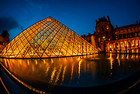 The Louvre Pyramid (Pyramide du Louvre) is a large glass and metal pyramid designed by Chinese-American architect I. M. Pei, surrounded by three smaller pyramids, in the main courtyard (Cour Napoléon) of the Louvre Palace (Palais du Louvre) in Paris. The large pyramid serves as the main entrance to the Louvre Museum. Paris, France.