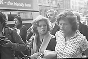 Fergus Rowan sits in at Bank of Ireland.  (J70)..1975..22.08.1975..08.22.1975..22nd August 1975..As a result of the 1970 bank strike which lasted for six months, the Rowan family business found itself in financial difficulties. During the strike the Rowans had had to accept cheques in good faith in order to stay in business. When the cheques came for settlement the bank refused as they stated that some were 'dodgy'. This put severe strain on the business which was eventually put into receivership.As part of the process the Rowan business beside the bank was put up for sale and was purchased by B.o I. Rowan was outraged and started a campaign against the bank which culminated in a sit in at the banks headquarters in Westmoreland St,Dublin. He also became a thorn in the side of the bank at the A.G.Ms raising many points...Picture shows Mr Rowan's daughter,Julie, being comforted by her aunt as they leave the bank.