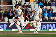 Rory Burns of England and Joe Denly of England running between the wickets during the International Test Match 2019, fourth test, day two match between England and Australia at Old Trafford, Manchester, England on 5 September 2019.