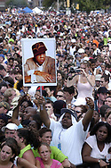 "PHILADELPHIA - JULY 2:  A fan holds a picture of Jay-Z in the crowd at ""Live 8 Philadelphia"" at the Philadelphia Museum of Art July 2, 2005 in Philadelphia, Pennsylvania. The free concert is one of ten simultaneous international gigs including London, Berlin, Rome, Paris, Barrie, Tokyo, Cornwall, Moscow and Johannesburg. The concerts precede the G8 summit (July 6-8) to raising awareness for MAKEpovertyHISTORY.  (Photo by William Thomas Cain/Getty Images)"