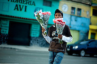 A street vendor sells roses in Guatemala City May 18, 2009. In recent days the country of Guatemala is dealing with unrest as the Presidnet Alvaro Colom and Guatemala's business elite are embroiled in a scandal involving money laundering, embezzling government funds and ordering assassinations, following the murder of a prominent lawyer Rodrigo Rosenberg. (Darren Hauck)