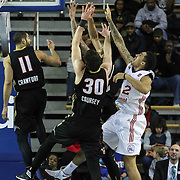 Delaware 87ers Forward Drew Gordon (32) drives towards the basket as Erie BayHawks Forward Daniel Coursey (30) and Erie BayHawks Guard Drew Crawford (11) defends in the first half of a NBA D-league regular season basketball game between the Delaware 87ers and the Erie BayHawk (Orlando magic) Friday, Jan. 02, 2015 at The Bob Carpenter Sports Convocation Center in Newark, DEL