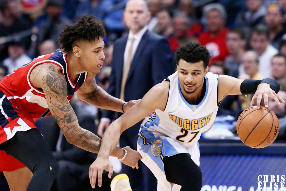 08 March 2017: Washington Wizards forward Kelly Oubre Jr. (12) defends on Denver Nuggets guard Jamal Murray (27) during the Washington Wizards 123-113 victory over the Denver Nuggets, at the Pepsi Center, Denver, Colorado, USA.