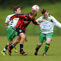 13 Aug 2016: Owen Morgan, Galway, in action against Rubin Doherty, left, and Matthew Flanagan, Donegal.   Boys U12 semi-final, Galway v Donegal.  2016 Community Games National Festival 2016.  Athlone Institute of Technology, Athlone, Co. Westmeath. Picture: Caroline Quinn