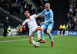 Milton Keynes Dons' Dean Lewington and Coventry City's Jack Grimmer battle for the ball during the Emirates FA Cup  Fourth Round match at  Stadium MK Milton Keynes.