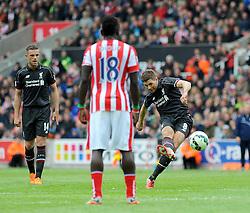Liverpool's Steven Gerrard attempts a shot at goal - Photo mandatory by-line: Nizaam Jones/JMP - Mobile: 07966 386802 - 24/05/2015 - SPORT - Football - Stoke - Britannia Stadium - Stoke City v Liverpool - Barclays Premier League