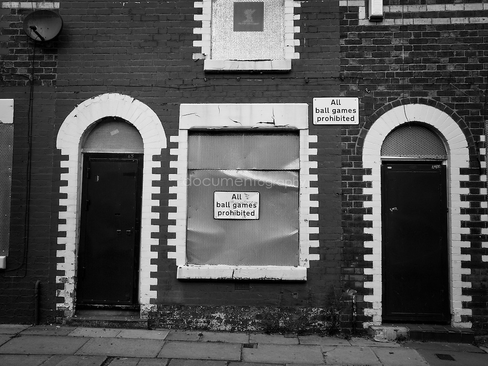 A sign prohibiting ball games on a boarded house in Anfield near Liverpool FC stadium...OLYMPUS DIGITAL CAMERA