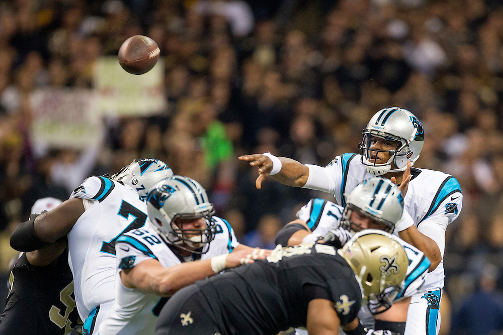 NEW ORLEANS, LA - DECEMBER 30:  Cam Newton #1 of the Carolina Panthers throws a pass against the New Orleans Saints at Mercedes-Benz Superdome on December 30, 2012 in New Orleans, Louisiana.  The Panthers defeated the Saints 44-38.  (Photo by Wesley Hitt/Getty Images) *** Local Caption *** Cam Newton