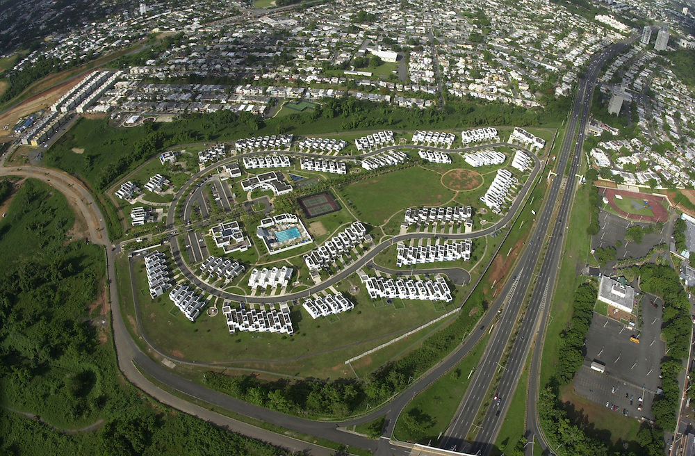 Aerial views of Ft. Buchanan housing area from a USCG HH-65B helicopter, stationed at Coast Guard Air Station Borinquen in Puerto Rico.  (U.S. Air Force photo/Master Sgt. Lance Cheung)