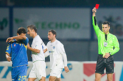 Wilson Xavier Junior of Domzale (L) on the way to wardrobe due to the red card by referee Slavko Vincic (R) during the football match between NK Domzale and MIK CM Celje, played in the 10th Round of Prva liga football league 2010 - 2011, on September 22, 2010, Spors park, Domzale, Slovenia. Domzale defeated Celje 1 - 0. (Photo by Vid Ponikvar / Sportida)