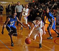 12 JAN. 2010 -- BRENTWOOD, Mo. -- Brentwood High School basketball player Tommy Lynch (10) splits a pair of Maplewood / Richmond Heights defenders during the neighborhood game between Maplewood and Brentwood Tuesday, Jan. 12, 2009 at Brentwood High School in Brentwood, Mo. Photo (c) copyright 2010 by Sid Hastings.