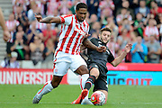 Glen Johnson and Adam Lallana tussle during the Barclays Premier League match between Stoke City and Liverpool at the Britannia Stadium, Stoke-on-Trent, England on 9 August 2015. Photo by Alan Franklin.