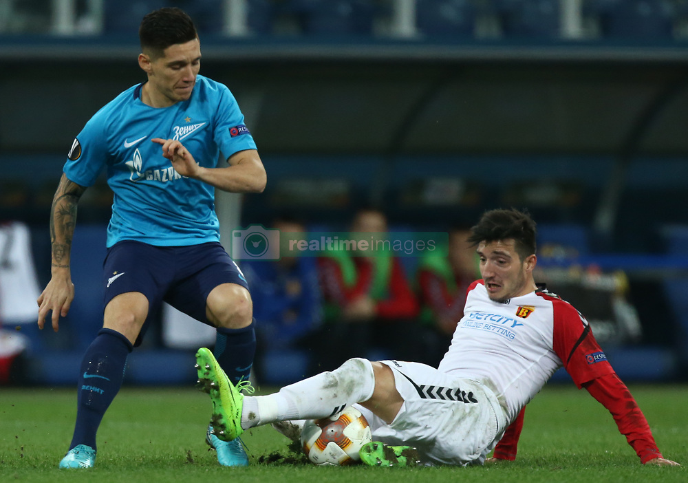 November 23, 2017 - Saint Petersburg, Russia - Matías Kranevitter of FC Zenit Saint Petersburg (L) and Vanja Markovic of FC Real Sociedad vie for the ball during the UEFA Europa League Group L football match between FC Zenit Saint Petersburg and FK Vardar at Saint Petersburg Stadium on November 23, 2017 in St.Petersburg, Russia. (Credit Image: © Igor Russak/NurPhoto via ZUMA Press)
