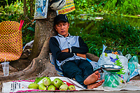 A street vendor selling produce takes a nap, near Cai Lay, Vietnam.