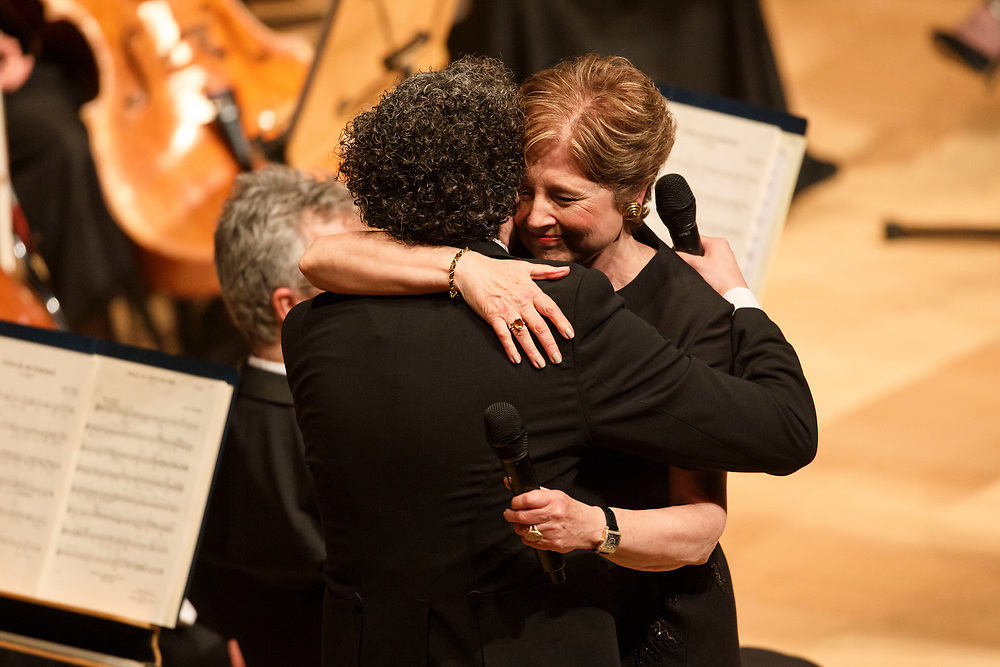 Outgoing LA Phil president Deborah Borda is embraced by conductor Gustavo Dudamel as she is honored during the LA Philharmonic performance at the Walt Disney Concert Hall on Thursday, May 18, 2017 in Los Angeles, Calif. The evening's performance featured Gustavo Dudamel's Schubert symphony as well as a tribute to outgoing president Deborah Borda, followed by a solo vocal from mezzo-soprano Sasha Cooke. © 2017 Patrick T. Fallon