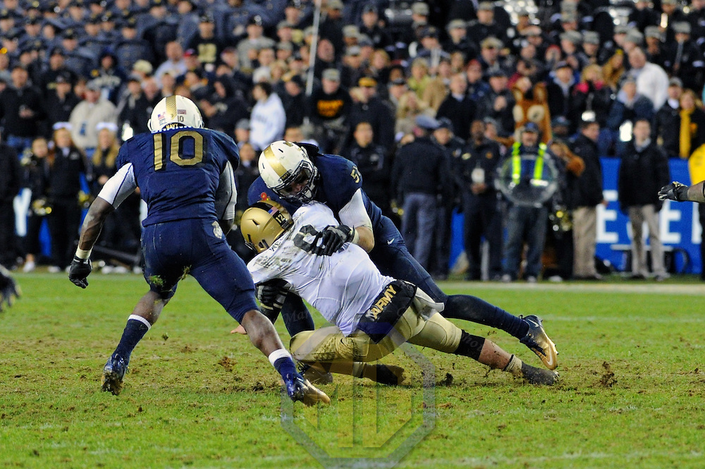 10 December 2011:   Army Black Knights quarterback Trent Steelman (8) is sacked by Navy Midshipmen linebacker Matt Warrick (51) in the 4th quarter at Fed Ex field in Landover, Md. in the 112th annual Army Navy game where Navy defeated Army, 27-21 for the 10th consecutive time.