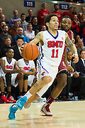 DALLAS, TX - FEBRUARY 19: Nic Moore #11 of the SMU Mustangs drives to the basket against the Temple Owls on February 19, 2015 at Moody Coliseum in Dallas, Texas.  (Photo by Cooper Neill/Getty Images) *** Local Caption *** Nic Moore