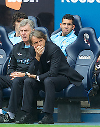 BOLTON, ENGLAND - Sunday, August 21, 2011: Manchester City's manager Roberto Mancini and substitute Carlos Tevez against Bolton Wanderers during the Premiership match at the Reebok Stadium. (Pic by David Rawcliffe/Propaganda)