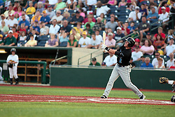 "1 June 2010: Kent Gerst takes a cut. The Windy City Thunderbolts are the opponents for the first home game in the history of the Normal Cornbelters in the new stadium coined the ""Corn Crib"" built on the campus of Heartland Community College in Normal Illinois."