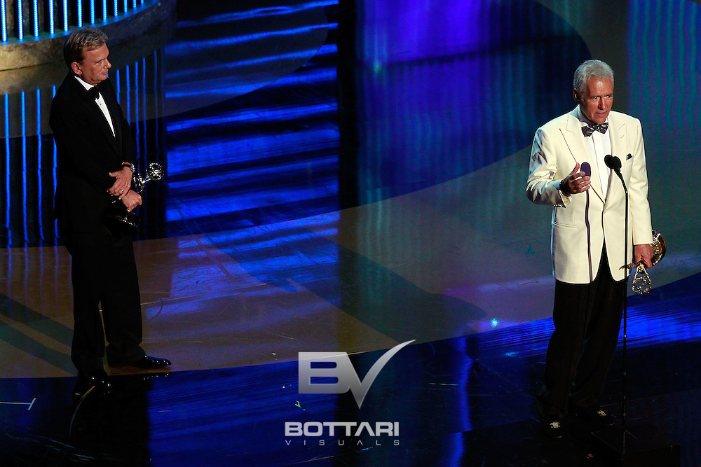 From left, Pat Sajak and Alex Trebek accept the Lifetime Achievement Award onstage during the Daytime Emmy Awards on Sunday June 19, 2011 in Las Vegas. (AP Photo/Jeff Bottari)