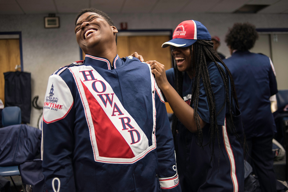 WASHINGTON,DC - October 7, 2017: Marquette Smith, who plays tenor sax, laughs as Lyric Fox, also on tenor sax, helps him get his cape on before the game.<br /> Howard University's Showtime Marching Band is part of a long tradition of outstanding bands at HBCU's. The band practices in the days leading up to a home game against North Carolina Central. (Andr&eacute; Chung for The Undefeated)