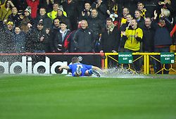 Watford's Jonathan Hogg slides in the water on the pitch towards the watfard fans after Referee Michael Naylor calls the game off - Photo mandatory by-line: Joe Meredith/JMP  - Tel: Mobile:07966 386802 26/12/2012 - Bristol City v Watford - SPORT - FOOTBALL - Championship -  Bristol  - Ashton Gate Stadium -