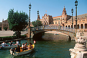 SPAIN, ANDALUSIA, SEVILLE Plaza de Espana bridge over lagoon