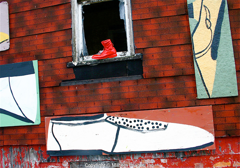 Red Shoe on Sill is part of an installation created by Detroit artist, Tyree Guyton for his Heidelberg Project.