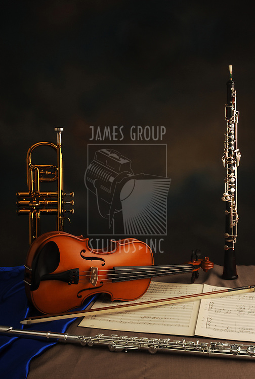 trumpet, violin, music, manuscript, oboe, flute in layout for full-page, full bleed background with empty space for headline and copy