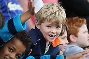 young AFC Wimbledon fan during the EFL Sky Bet League 1 match between AFC Wimbledon and Rochdale at the Cherry Red Records Stadium, Kingston, England on 30 September 2017. Photo by Matthew Redman.