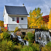 Little White House in Chicoutimi, Saguenay, Canada<br /> On July 19 and 20, 1996, a massive thunderstorm pounded Chicoutimi. The nearly ten inches of torrential rain triggered a catastrophic event know as The Saguenay Flood. Huge volumes of water overcame five dams and spillways before thundering into the Bassin District. The surge totally destroyed or severely damaged hundreds of houses. Only one remained standing: the former home of Elzéard Gagnon built in 1890. La Petite Maison Blanche (The Little White House) is now a museum about the flood. Notice the water pouring out of the red door. Surrounding the historic landmark is a municipal park where the neighboring residences were previously located.