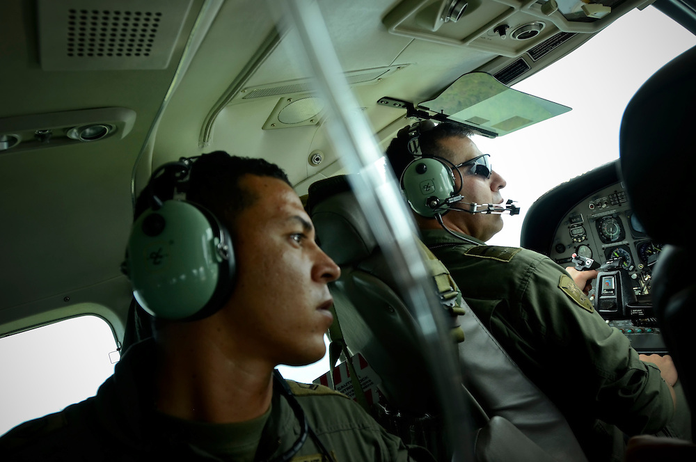 Alejandro Suarez Isaza, 28, (left) and Lieutenant Colonel Jair Cortez, 42, (right) of the Colombian Air Force search for the wreckage of the plane crash that killed Gordon Radley's brother in 1962.  They were unable to locate the wreckage in the dense jungle. Gordon Radley promised that he would someday retrace the last steps of his brother, and complete the journey from Bahía Solano to Quibdó that his brother died trying to make.