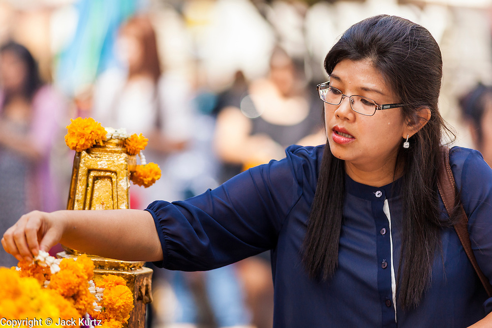 "20 MAY 2104 - BANGKOK, THAILAND: A woman prays at Erawan Shrine in Bangkok after the Thai army declared martial law. The Thai Army declared martial law throughout Thailand in response to growing political tensions between anti-government protests led by Suthep Thaugsuban and pro-government protests led by the ""Red Shirts"" who support ousted Prime Minister Yingluck Shinawatra. Despite the declaration of martial law, daily life went on in Bangkok in a normal fashion. There were small isolated protests against martial law, which some Thais called a coup, but there was no violence.   PHOTO BY JACK KURTZ"