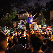 March 31, 2012 - Lexington, Kentucky, USA - From atop an overturned car, University of Kentucky basketball fans celebrate their team's victory over the University of Louisville in Lexington, Ky., on March 31, 2012. The win for Kentucky advances them to the championship game of the NCAA tournament in New Orleans. Fans took to the streets and in burned couches, turned over a car and ending with a handful of arrests. (Credit image: © David Stephenson/ZUMA Press)