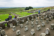 Begun around AD 124 and occupied for 280 years, Housesteads Roman Fort (Vercovicium) is the best preserved fort along Hadrian's Wall. Find it near Bardon Mill, Northumberland, England, United Kingdom, Europe. As the Roman Empire's largest artifact, Hadrian's Wall runs 117.5 kilometres (73.0 miles) across northern England from the banks of River Tyne near the North Sea to Solway Firth on the Irish Sea. Much of the wall still stands and can be walked along the adjoining Hadrian's Wall Path. Within the Roman province of Britannia, it defended the northwest frontier of the Roman Empire for nearly 300 years. It was built by the Roman army on the orders of the emperor Hadrian in the 6 years following his visit to Britain in AD 122. Hadrian's Wall is honored as a World Heritage Site. The wall lies entirely within England, and is unrelated to the Scottish border, which lies north of the wall at distances varying from 1-109 kilometers (0.6-68 miles) away.