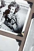 childhood beach scene images in a photo album