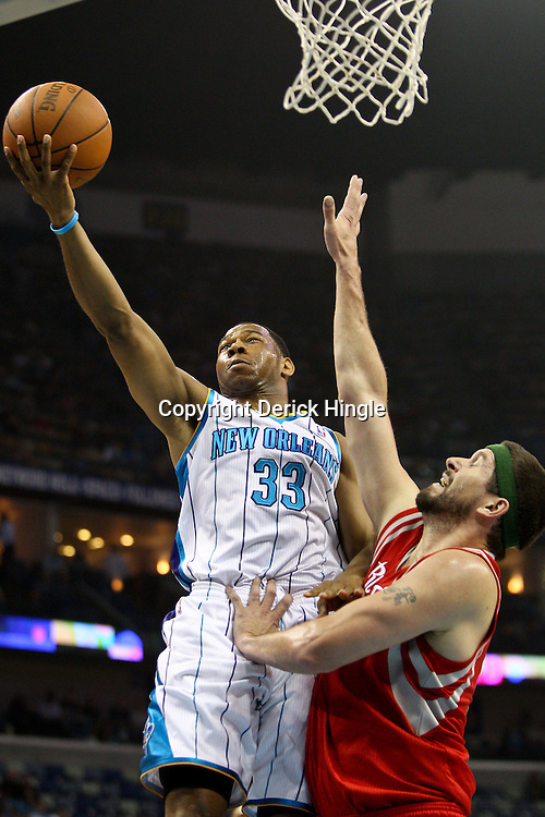April 6, 2011; New Orleans, LA, USA; New Orleans Hornets shooting guard Willie Green (33) shoots over Houston Rockets center Brad Miller (52) during the first half at the New Orleans Arena.   Mandatory Credit: Derick E. Hingle-US PRESSWIRE