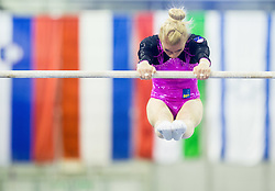 Teja Belak of Slovenia competes in the Uneven Bars during Qualifiying day  of Artistic Gymnastics World Challenge Cup Ljubljana, on April 18, 2014 in Hala Tivoli, Ljubljana, Slovenia. Photo by Vid Ponikvar / Sportida