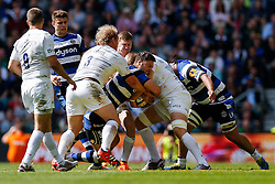 Bath Winger Matt Banahan is tackled by Saracens Prop Petrus Du Plessis, Saracens replacement Jackson Wray and Winger David Strettle - Photo mandatory by-line: Rogan Thomson/JMP - 07966 386802 - 30/05/2015 - SPORT - RUGBY UNION - London, England - Twickenham Stadium - Bath Rugby v Saracens - 2015 Aviva Premiership Final.