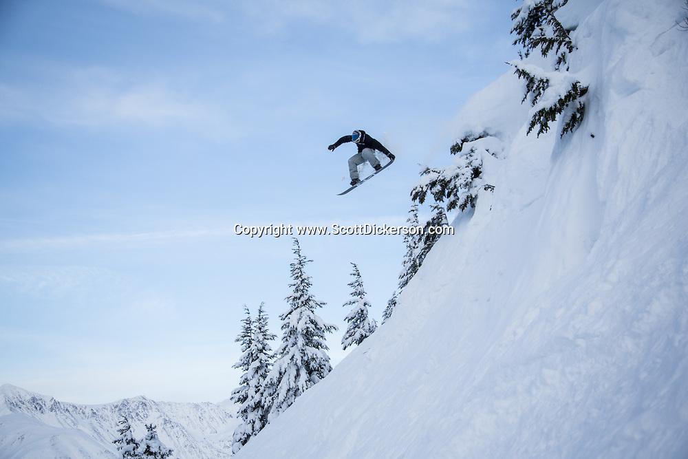 Nathan Ellis snowboarding at Alyeska Resort in Girdwood, Alaska.