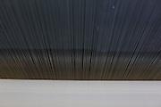 Montes Claros_MG, Brasil.<br /> <br /> Na foto, uma urdideira, maquina que passa os fios das bobinas menores pra uma maior no setor de fiacao da fabrica de Tecidos em Montes Claros, Minas Gerais.<br /> <br /> The textile factory in Montes Claros, Minas Gerais.<br /> <br /> Foto: LEO DRUMOND / NITRO