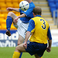 St Johnstone v Queen of the South...09.08.03<br />Mark Baxter clears from Joseph McAlpine<br /><br />Picture by Graeme Hart.<br />Copyright Perthshire Picture Agency<br />Tel: 01738 623350  Mobile: 07990 594431