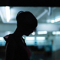 Silhouette of female youth in urban environment