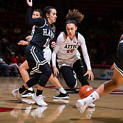09 November 2018: San Diego State Aztecs guard Naje Murray (10) drives the ball into the key while being defended by Hawaii Warriors guard Tia Kanoa (11) in the first quarter. The Aztecs opened up it's regular season schedule with a 58-57 win over Hawaii Friday at Viejas Arena.