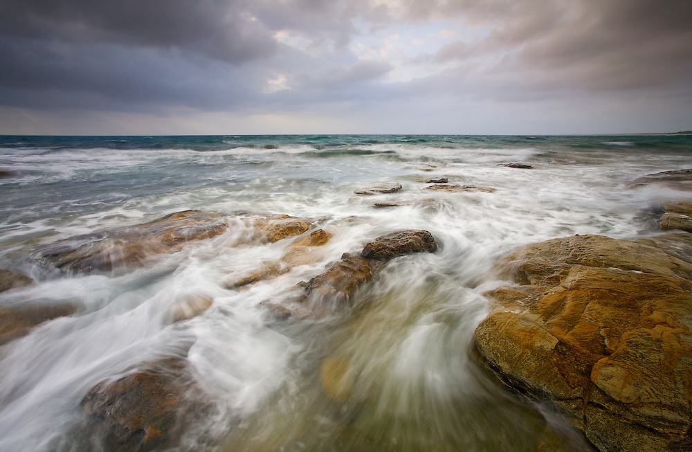 The spirited sea and changeable skies make for a dramatic early morning capture.