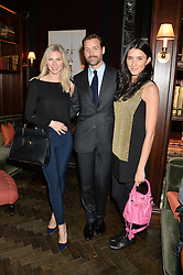 Left to right, JULIA RANSOM, PATRICK GRANT and YOSUZI SYLVESTER at the Installation And Reveal Of Gerald Scarfe's Exclusive Artworks In Scarfes Bar at the Rosewood Hotel, 252 High Holborn, London on 7th April 2014.